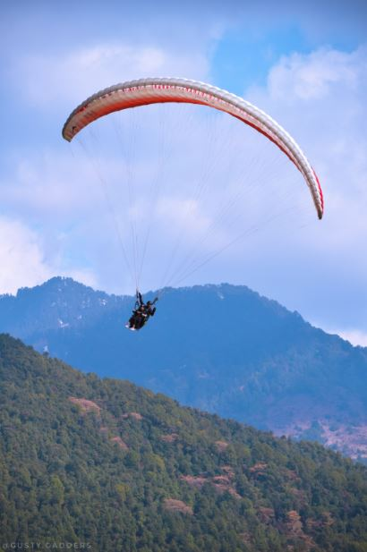 A girl paragliding at Billing, Himachal Pradesh