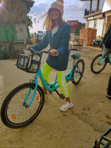 A girl on bicycle in neon pants