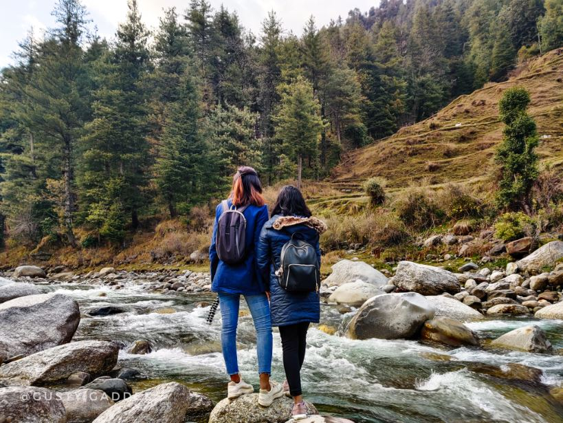 Two girls standing at Zero Point, Uhl River Barot Valley