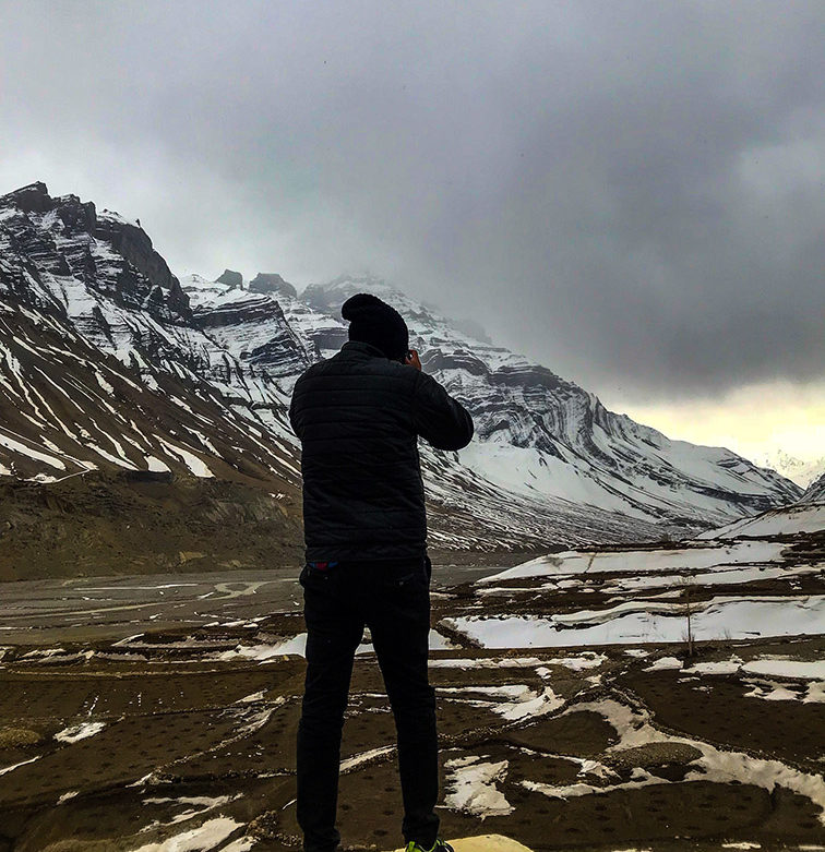 Travel Photographer Clicking a Photograph in Spiti