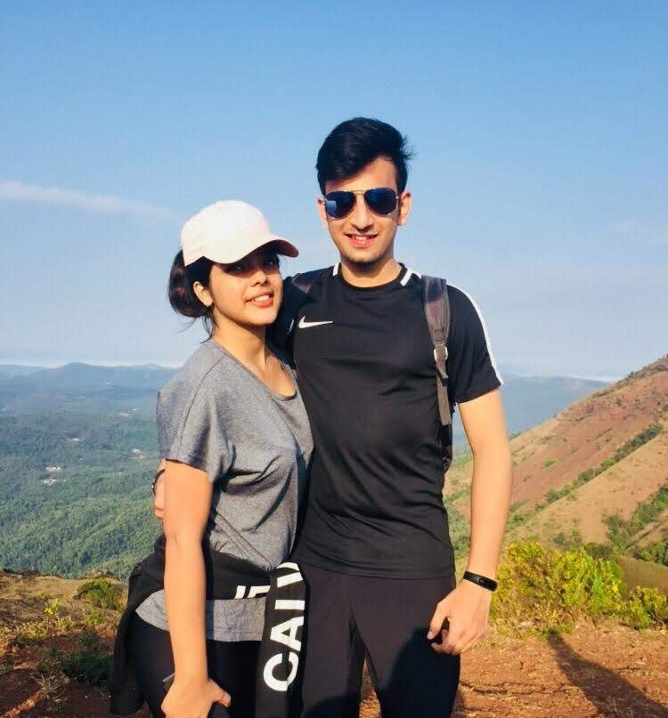 A Boy & Girl standing at Mullayangiri Peak in Chikmaglur